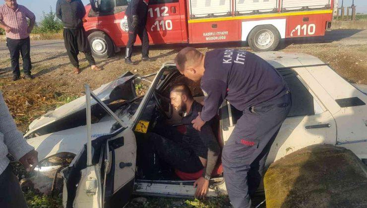 Tarlaya uçan otomobilin sürücüsü yaralandı